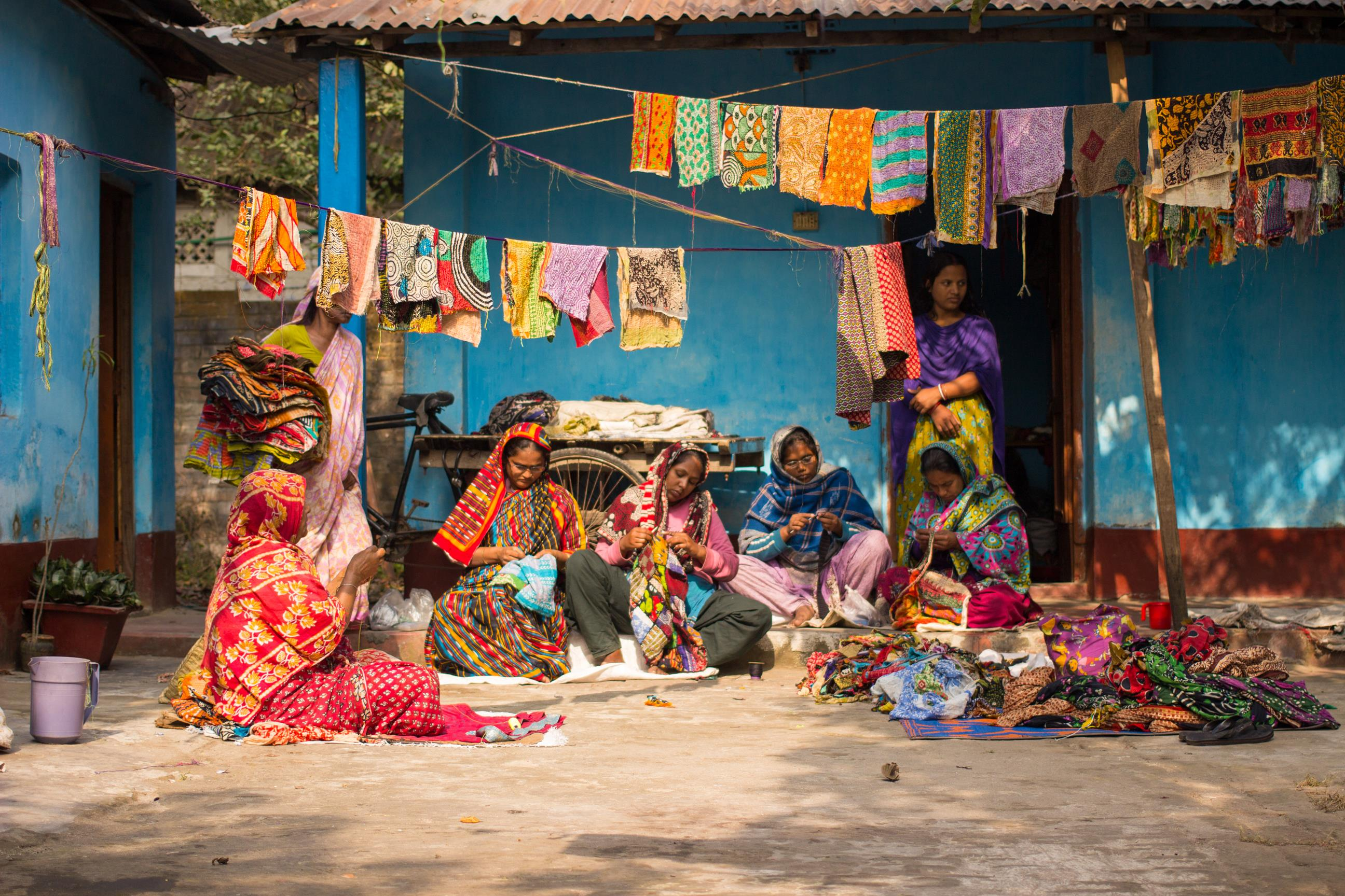 Women of the Hajiganj Group workshop in Bangladesh's Nilphamari District making recycled sari wrap baskets.