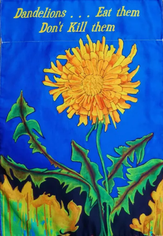 yard flag with painted dandelion and the words eat them don't kill them