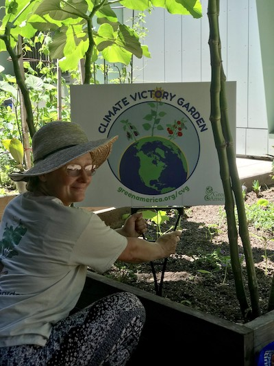 woman holding gardening sign