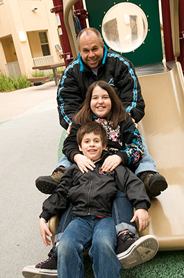 Family on a playground in Chula Vista, CA