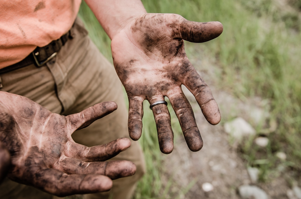 image of a farmer's dirt-covered hands