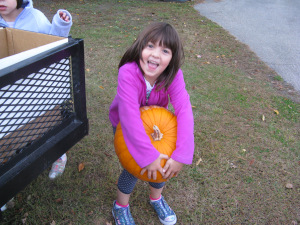 "My oldest daughter a few years ago at what she calls ""the Pumpkin Cart of Honesty,"" in which a neighbor grows pumpkins and simply sets them out on a cart with a cash box and trusts that people will pay for what they take."