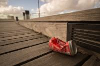 can of coke on sidewalk