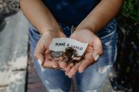 "hands holding coin change with words saying ""make a change"""