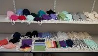 multicolored face masks on a white shelf