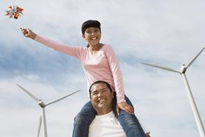 man and girl with windmills