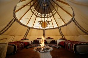 inside the 18ft Nomadics tipi, beautifully decorated