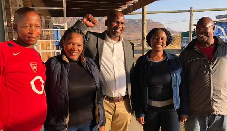 A coalition of workers and feminist organizations after reaching a landmark agreement in Lesotho