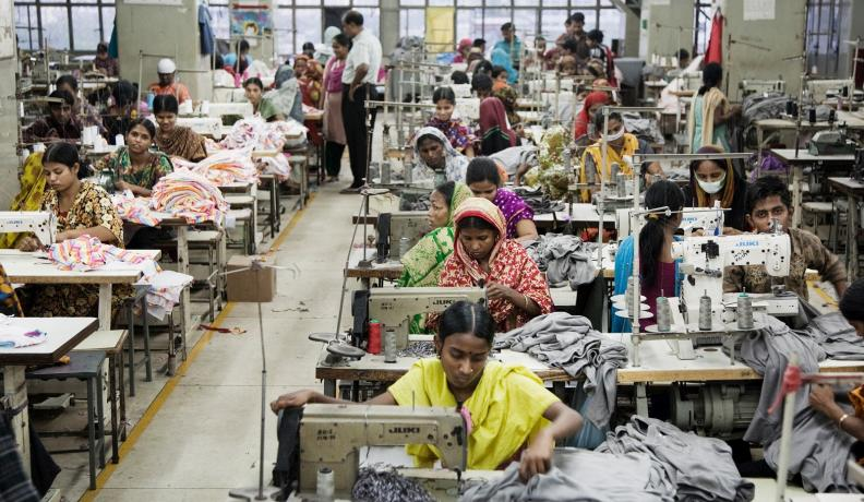 factory garment workers in crowded room