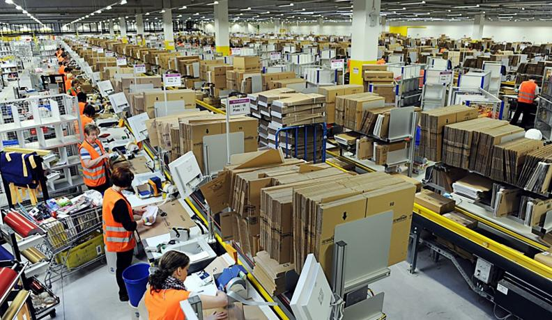Amazon workers packaging items in a warehouse