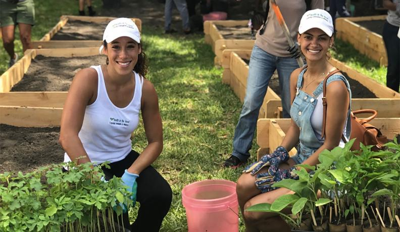 two women working in a regenerative garden
