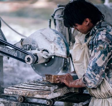 Image: laborer working with machinery. Fair labor.