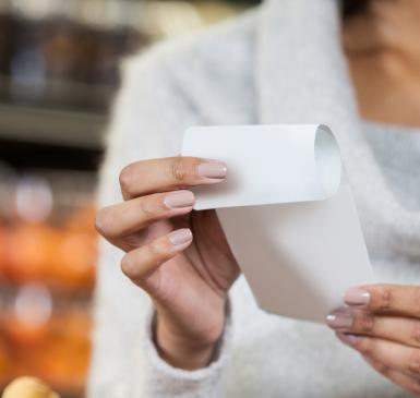 woman holding paper receipts