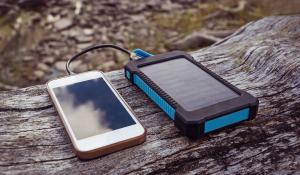 phone being charged by small solar panel