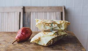 beeswrap sandwiches and a pear